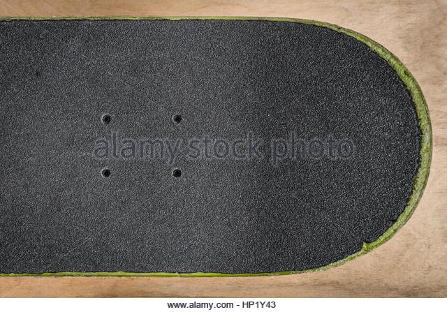 top-view-of-a-skateboard-and-griptape-in-skatepark-hp1y43